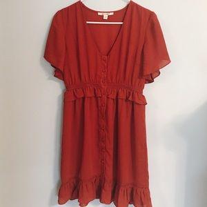 Francesca's rust colored dress
